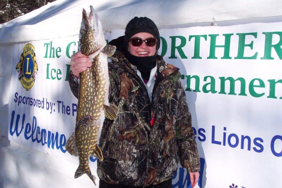 Holding fish, ice fishing tournament