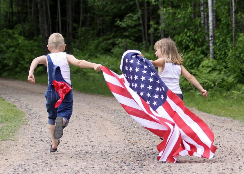 kids running with flag